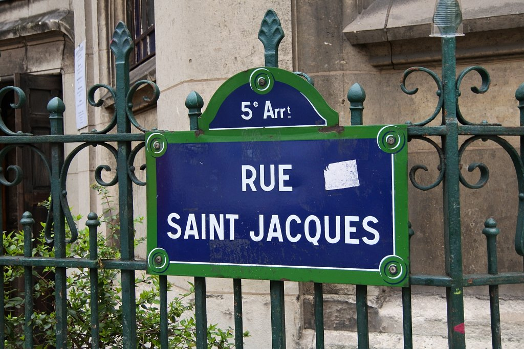 Street sign on the church's fence